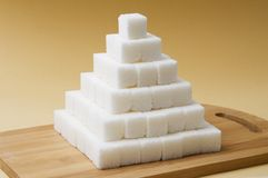 Sugar cubes pyramid Stock Image