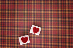 Sugar cubes with a red heart on them. Top view. Sweet addiction valentine day concept Royalty Free Stock Image
