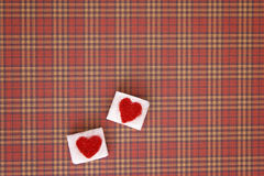 Sugar cubes with a red heart on them. Top view. Sweet addiction valentines day concept Stock Photos