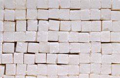 Sugar cubes stacked. White sugar cubes background with studio light Royalty Free Stock Photos
