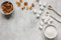 Sugar cubes on stone table background top view mockup Stock Photography