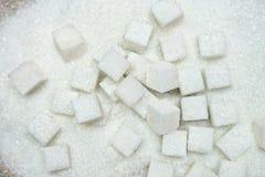 Sugar cubes on sugar pile, high sugar level and diabetes concept Stock Image
