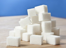 Sugar cubes on a table Stock Images