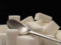 Sugar cubes and tea-spoon Stock Photo