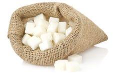 Sugar cubes on white. Background Stock Image