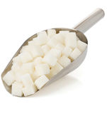 Sugar cubes on white. Background Stock Photography