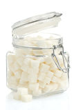 Sugar cubes on white. Sugar cubes in pot on white background Royalty Free Stock Photo