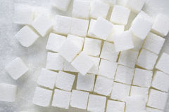 Sugar cubes on white background Royalty Free Stock Image