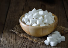Sugar cubes in wood bowl Royalty Free Stock Images