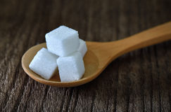 Sugar cubes in wood spoon Royalty Free Stock Image
