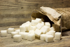 Sugar cubes. On wooden background Royalty Free Stock Images