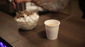 Sugar and a cup of fresh coffee stock video footage