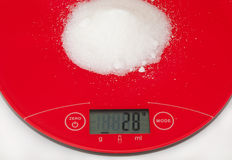 Sugar and digital scale Royalty Free Stock Photography