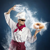 Sugar donut. Chef sprinkle powdered sugar donut Royalty Free Stock Photos
