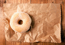 Sugar doughnut on crumpled paper Stock Photos