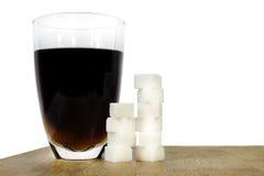 Sugar drink. A comparison of how many sugar cubes a sugar drink has Stock Photo