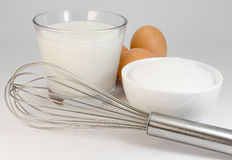 Sugar, eggs, milk, whisk Royalty Free Stock Image