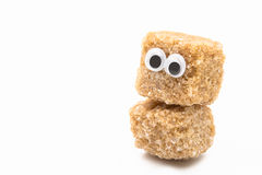 Sugar face. Brown sugar monster with googly eyes on white background Stock Images