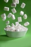 Sugar falling down. White sugar cubes falling down Stock Photos