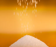 Sugar falling to pile Royalty Free Stock Photos