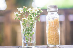 Sugar and flower. In the glass on the table Stock Photo