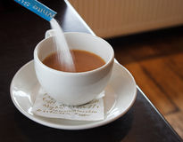 Sugar Flowing Into A Cup Royalty Free Stock Photography