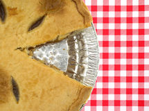 A sugar free apple pie with one slice cut out Royalty Free Stock Photos