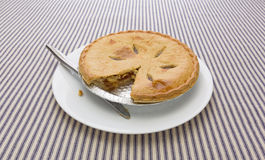 A sugar free apple pie with one slice cut out Royalty Free Stock Photography