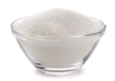 Sugar. In glass bowl isolated on white royalty free stock photos