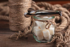 Sugar in glass vintage jar on wooden table. Royalty Free Stock Photos
