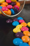 Sugar glazed chocolate buttons in jar royalty free stock images