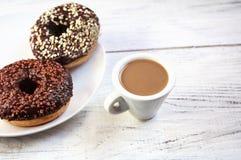 Sugar glazed donuts with mug coffee Royalty Free Stock Photo