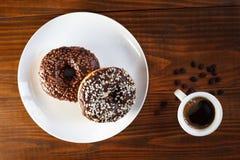 Sugar glazed donuts with mug coffee Royalty Free Stock Image