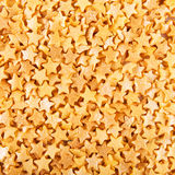 Sugar gold asterisks background Stock Photos