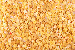 Sugar gold asterisks background Stock Images