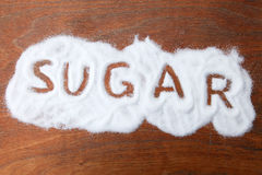 Sugar. Grains of sugar on the table with the word'sugar royalty free stock photography