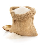 Sugar granules in bag on white Stock Image