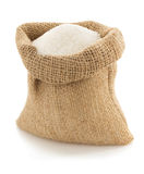 Sugar granules in bag on white Stock Image