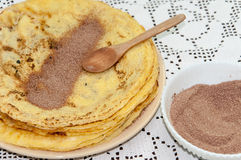 Sugar with grounded cocoa on the pancakes Royalty Free Stock Image