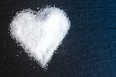 Sugar heart on black background macro close up. Crystal Royalty Free Stock Photography