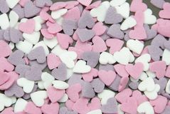 Sugar heart's. Background composed by hearts of sugar with different colours royalty free stock images