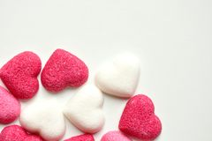 Sugar with heart shapes on white background Royalty Free Stock Image