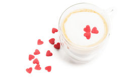 Sugar hearts on espresso with milk foam Royalty Free Stock Image