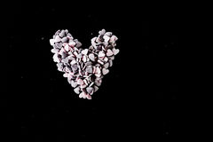 Sugar hearts. Color candy hearts on a black background royalty free stock photography