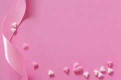 Sugar hearts and gift ribbon of pink backround Royalty Free Stock Image