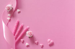 Sugar hearts, roses, candles and gift ribbon of pink backround Royalty Free Stock Images