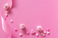 Sugar hearts, roses and gift ribbon of pink backround Royalty Free Stock Images