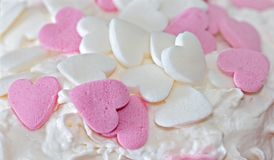 Sugar hearts on whipped cream Royalty Free Stock Photos