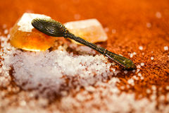 A spoon and sugar crystals Royalty Free Stock Photography