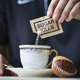 Sugar kills paper pack. Filling a cup of coffee Stock Photos
